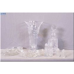 A selection of crystal and glass collectibles including pinwheel decanter, Mikasa crystal vase, salt