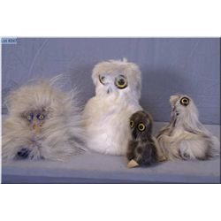 Four handcrafted seal skin and fur birds