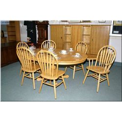 Semi Contemporary centre pedestal oak dining table with two leaves and six chairs