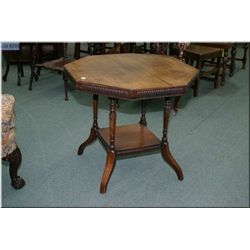 Antique two tier parlour table with decorative skirt on each tier and turned supports