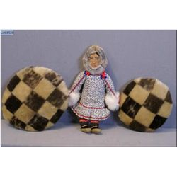 Two handcrafted seal skin pillows and a handmade Inuit doll
