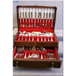 A wooden canteen containing silverplate flatware service for twelve including dinner forks, knives,