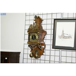 Dutch wall clock with figural cast decoration and internal pendulum