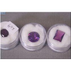 Three cases of loose gemstones
