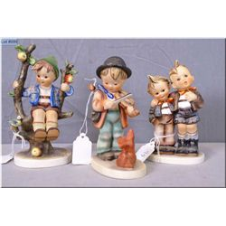 """Three Hummel figurines including """"Appletree Boy"""", """"Max and Moritz"""" and """"Puppy Love"""""""