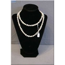 """A single strand of 32"""" freshwater pearls"""