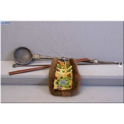 A handmade beaded leather purse and a spelter ladle and spatula