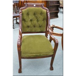 An Antique Edwardian button tufted open arm parlour chair with ball and claw feet