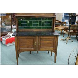 An antique English washstand with inlaid decoration, marble top and tiled back