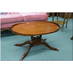 Mahogany coffee table with lyre pedestal and brass capped claw feet