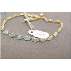 Lady's 14kt yellow gold and Australian fire opal tennis bracelet