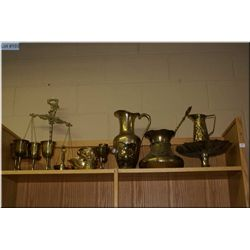 A selection of brass including scales of justice, goblets, large pitcher, masks etc.