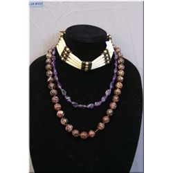 Two gemstone necklaces and a Southwestern style bone choker
