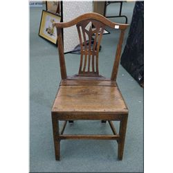 An interesting antique sidechair with on piece T-back insert