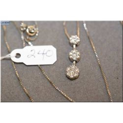 Lady's 14kt white gold and diamond pendant. Set with 0.57ct of brilliant diamonds with a 14kt white