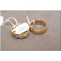 Two vintage 10kt gold bands including one set with three accent diamonds in white gold