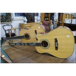 Two six string acoustic guitars, both with distress