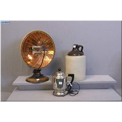Selection of vintage collectibles including Majestic fan, electric tea kettle, and a stoneware jug