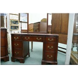 A mahogany mirrored vanity by Drexel to match lot 533