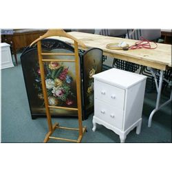 A small modern painted three panel screen and a two drawer end table and a gentleman's suit rack on