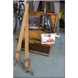 Vintage wooden toolbox containing battery charger, reciprocating saw, etc and two carpentry clamps