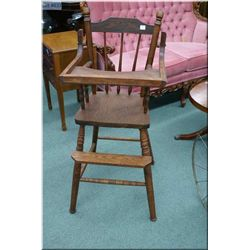 A pressed back highchair with fold up tray