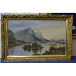 """A gilt framed oil on canvas painting of Coastal Islands and Mountain, no signature found 22"""" x 56"""""""