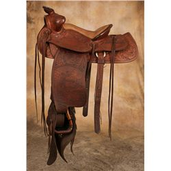 Heavily Carved Pictorial Saddle