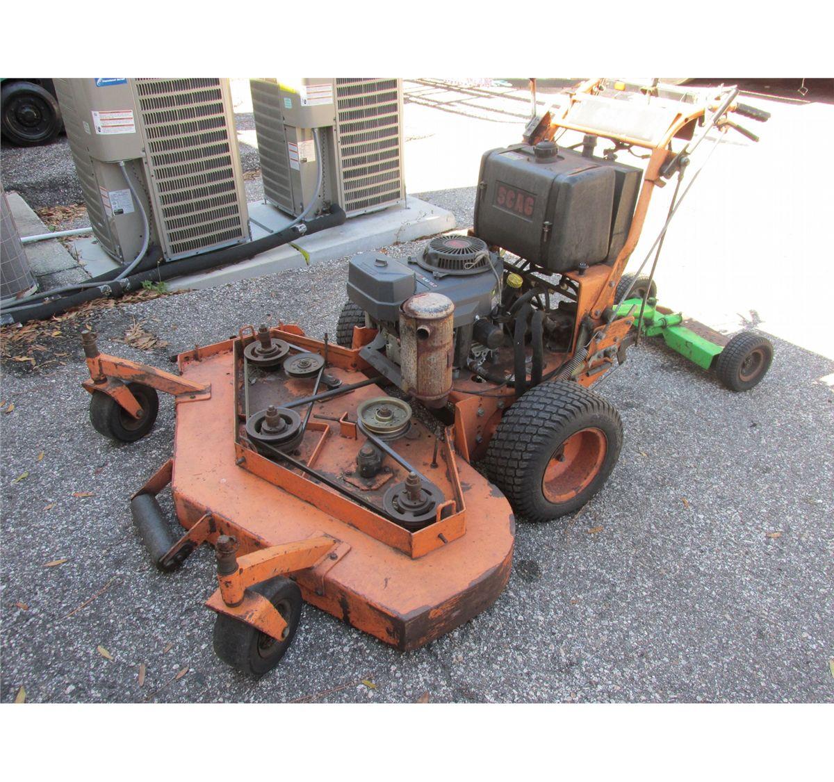 Scag walk-behind mower, sulky, 2 yr  old Kawasaki engine, 52