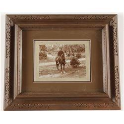 Framed Photography of Man on Horseback