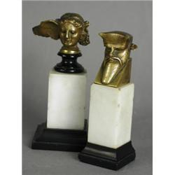 Two miniature bronze busts of mythological figures, both raised on a