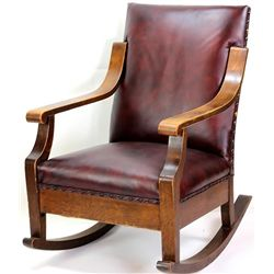 Heavy solid oak rocking chair with oxblood