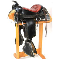 Vintage black and read unmarked saddle