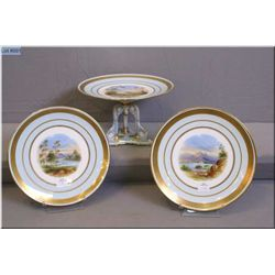 Three antique unmarked porcelain cabinet pieces including two plates and raised bowl with an interes