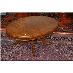 Victorian matched burl grain coffee table with interesting quad support center pedestal and original