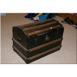 Antique dome topped and oak bound steamer trunk