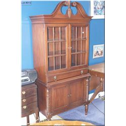 Vintage mahogany display/storage cabinet with twist columns, lion's head motif pulls and finial