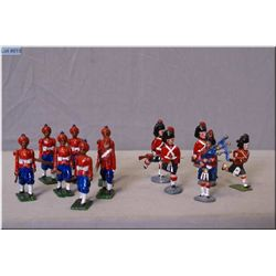 Metal soldiers including assorted Scottish soldiers; four running and one piper and Seven Punjaby fi