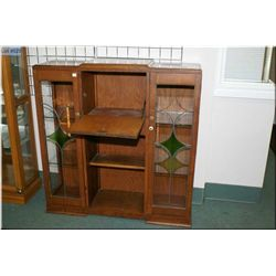 A Deco style drop front cabinet with double glazed and leaded glass doors
