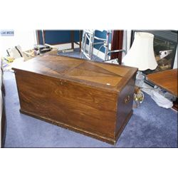 Large decorative storage chest with inlaid top and hand hammered hinges
