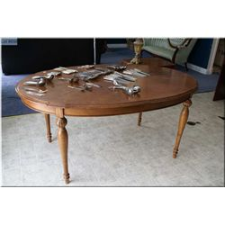 Match grain dining table with turned supports
