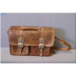 An American West hand tooled leather handbag