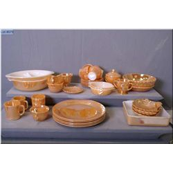 Large selection of Fire King iridescent peach dishes including five dinner plates, six cups and sauc