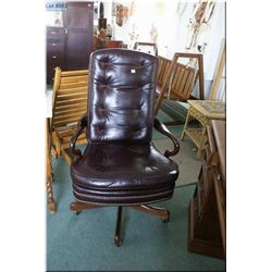 Leather upholstered swivel office chair on castors