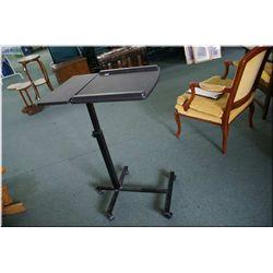 Tilt top telescoping table on castors