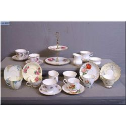 A large selection of collectible tea cups and saucers including Royal Albert, Aynsley, Paragon, Quee
