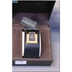 A boxed ladies Gucci watch with black leather strap in original packaging