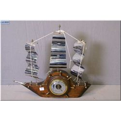 A vintage Ship and ship's wheel motif barometer