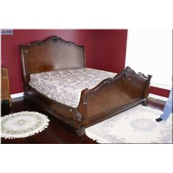 Semi contemporary king sleigh bed with carved decorations including headboard, footboard and rails