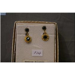 A pair of vintage natural gold nugget earrings set with black Alaskan diamond stone